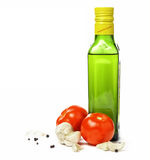 Olive oil, garlic, pepper and vegetables over white. (with sample text Royalty Free Stock Image