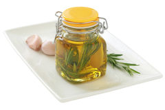 Olive oil with garlic and rosemary Stock Photo