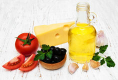 Olive oil, garlic, tomato and cheese Stock Photography