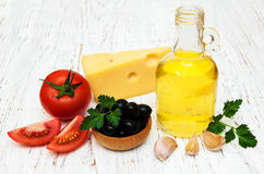 Olive oil, garlic, tomato and cheese Royalty Free Stock Photo