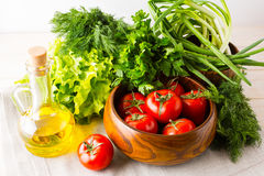 Olive oil, garlic and tomato in wooden bowl Stock Photography