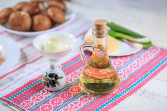Olive oil. In a glass bottle and capacity for spice Stock Photography