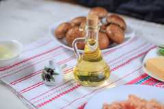 Olive oil. In a glass bottle and capacity for spice Royalty Free Stock Photos