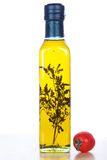 Olive oil in glass bottle  and cherry tomato Stock Image