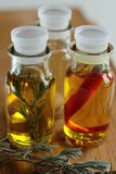 Olive oil in glass bottles Stock Images