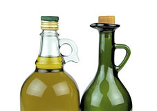 Olive oil in glass bottles on white background Stock Photos