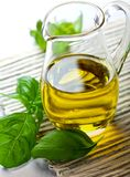 Olive oil in a glass jug Royalty Free Stock Photography