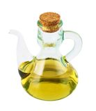 Olive oil glass vessel isolated Stock Photography