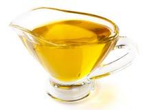Olive oil in gravy boat,  on white Royalty Free Stock Image