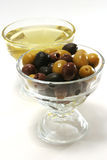 Olive oil with green, black and brown olives Stock Image