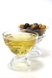 Olive oil with green, black and brown olives. Inside bowls Royalty Free Stock Image