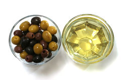 Olive oil with green, black and brown olives. Top view Stock Photo