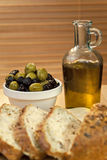 Olive Oil, Green & Black Olives & Rustic Bread Stock Images
