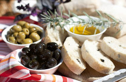 Olive oil, green and black olives on the table Stock Photo