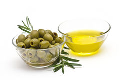 Olive oil and green olives Royalty Free Stock Photos