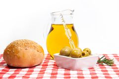 Olive oil, green olives and bread Royalty Free Stock Photos