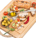 Olive oil with green olives and bread on a wooden  board Stock Photos