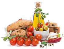 Olive oil with green olives, tomatoes and bread Royalty Free Stock Photos