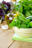 Olive oil and greens Stock Photography