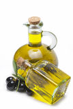 OLive oil for a healthy dieting. Jars with olive oil and some olives isolated over a white background stock photography