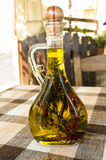 Olive oil. With herb, blurry background Stock Photos