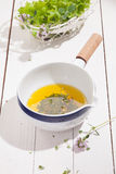 Olive oil and herb salad dressing Royalty Free Stock Images