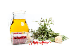 Olive oil and herbs. Isolated over white Royalty Free Stock Photography
