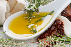 Olive Oil with Herbs Royalty Free Stock Photos
