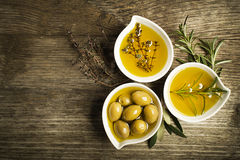 Olive oil with herbs Stock Image