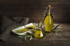 Olive Oil bottle with herbs royalty free stock photos