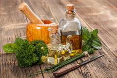 Olive oil  and herbs. On rustic wooden background Stock Photo