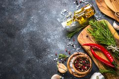 Olive oil, herbs and spices on a dark stone table. Ingredients for cooking, Top view, Copy space stock images