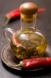 Olive oil with herbs and spices in glass bottle Royalty Free Stock Images