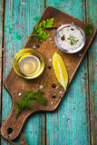 Olive oil, herbs and spices on wooden background Royalty Free Stock Photos