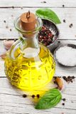 Olive oil, herbs and spices. On wooden table. Cooking concept Royalty Free Stock Photo