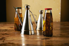 Olive oil with herbs and steel dispensers Stock Photo