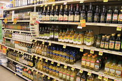 Olive oil. Isle in supermarket  with different brands of olive oil Royalty Free Stock Images