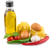 Olive oil, Italian noodles, tomatoes, garlic and basil on white Stock Photography