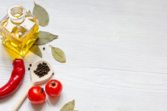 Olive oil in jar on wooden background with spices Stock Images