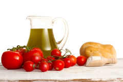 Olive oil jud and tomatoes Royalty Free Stock Photos