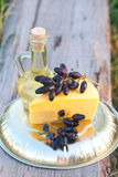 Olive oil in the jug, cheese, dark blue grapes Royalty Free Stock Photos