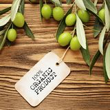 Olive oil label. Olives over wooden background and olive oil label Royalty Free Stock Photography