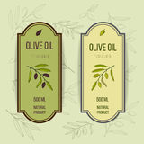 Olive oil label template. Hand drawn vector illustration Stock Images