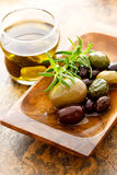 Olive oil and mixed olives Stock Images