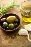 Olive oil and mixed olives Royalty Free Stock Photos
