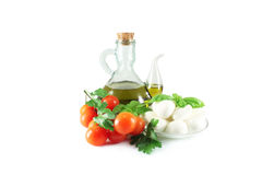 Olive oil, mozzarella, basil and tomatoes Royalty Free Stock Image