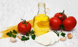 Olive oil, mozzarella cheese, spaghetti, garlic and tomatoes Royalty Free Stock Photography