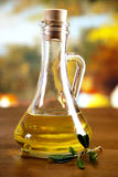 Olive oil and olive tree leafs Stock Photography
