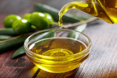 Olive oil and olive twig Royalty Free Stock Photos