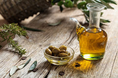 Olive oil and olive twig on a table Stock Images